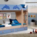 дизайн кроватки дельфин для ребенка в теплых тонах