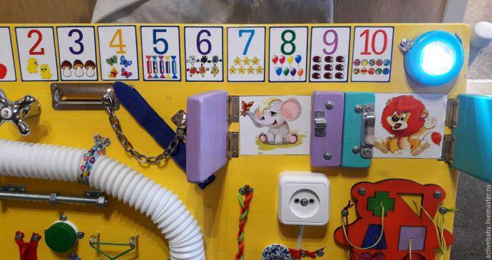 развивающая досточка для ребенка с часами